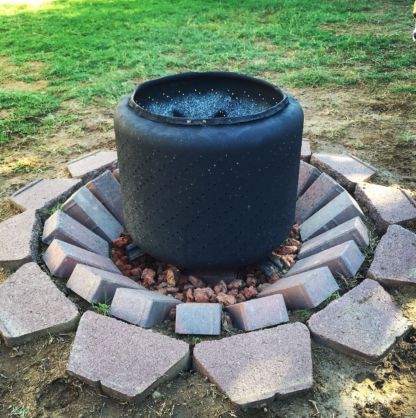 turn your old washer drum into a rustic outdoor fire pit the