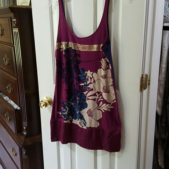 Express tank dress Express size medium tank dress fuchsia color with floral print has ribbon-like banded bottom in excellent condition see last photo one flower has a small spot where fuchsia color bled onto flower or happened during screen print not very noticeable as its really cute on Express Dresses Mini