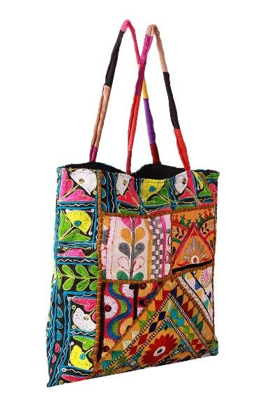 6f577bcf94 Intricate art work painstakingly done by banjara tribe of kutch. This tote  bag comes with