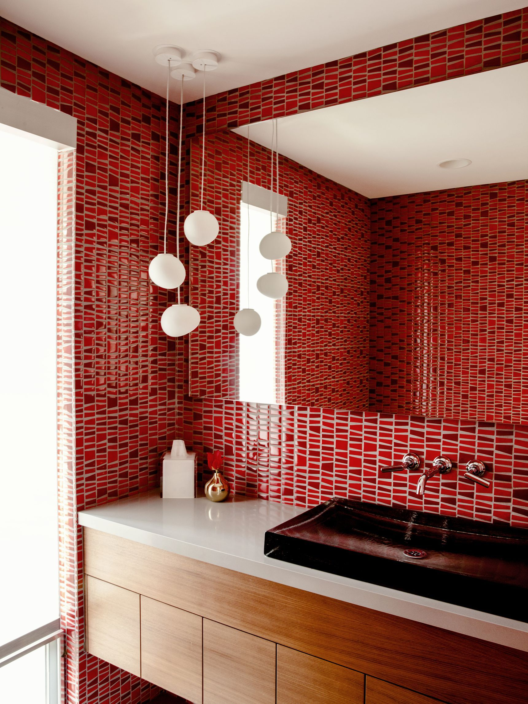 A powder room is covered in bright red tile.   Bathroom ...