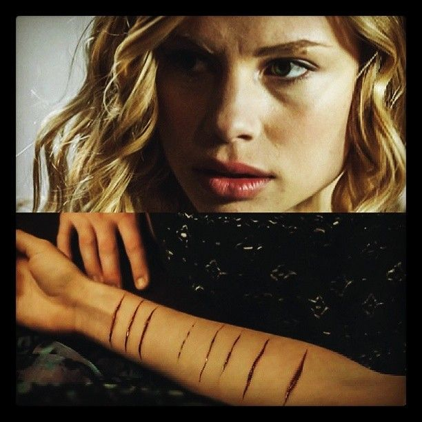 Lissa Dragomir. I wish the movie would have shown her struggle with self harm, rather than the cut marks just appearing when she used her energy to heal someone. The book is way better.