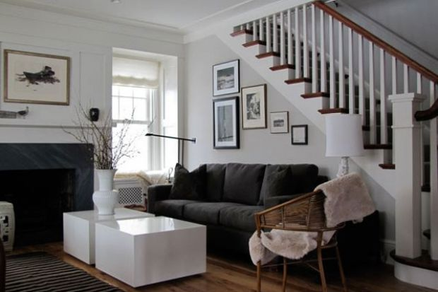 Classic old farmhouse in Minneapolis goes modern with custom sofa from A. Rudin, lacquer cube coffee tables, vintage rattan chair with sheepskin throw.  (interior by alecia stevens)