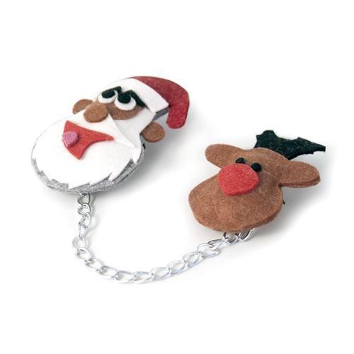 DOPPIA SPILLA SANTA CLAUS  -  Doppia spilla con catenella in metallo decorata da simpatico Babbo Natale e la sua renna.