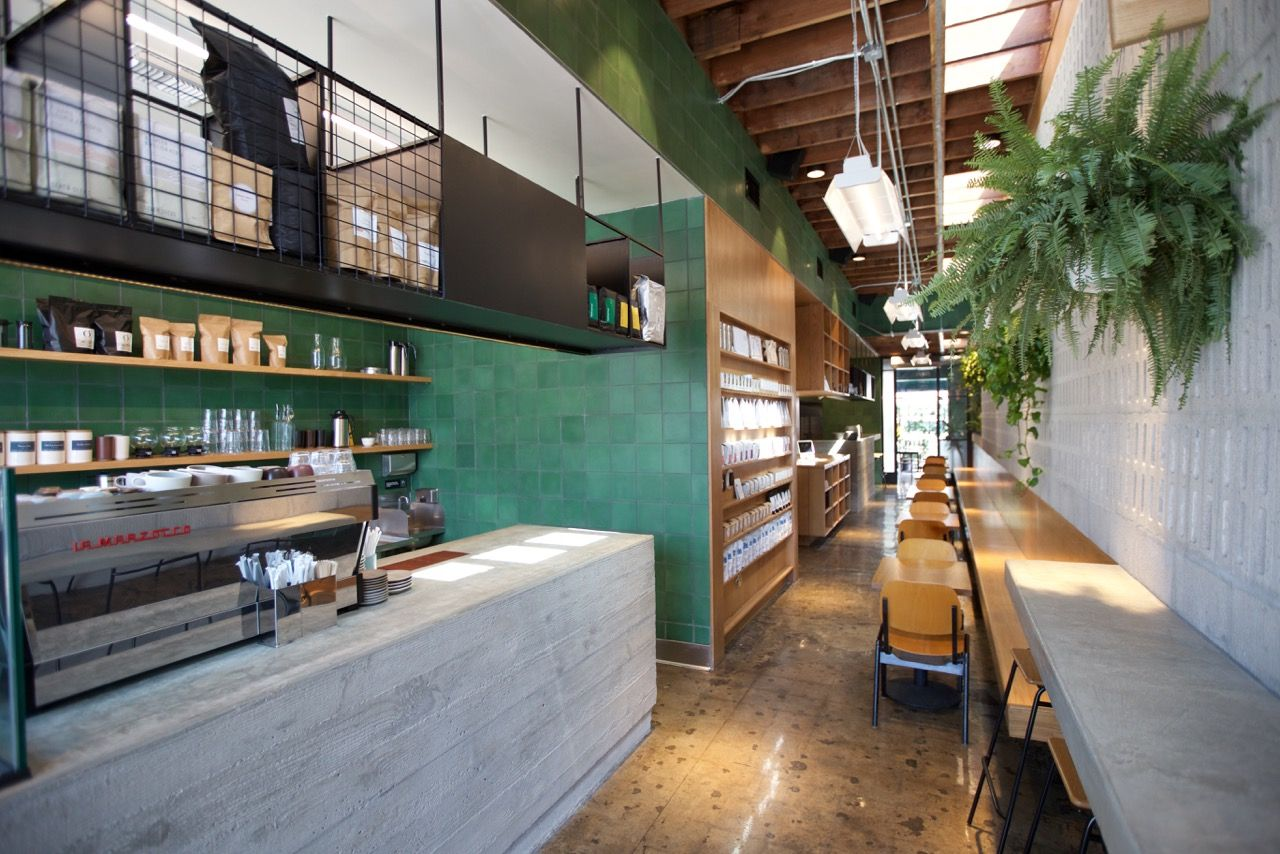 restaurant visit concrete and green at an australian cafe in la - Concrete Cafe Interior