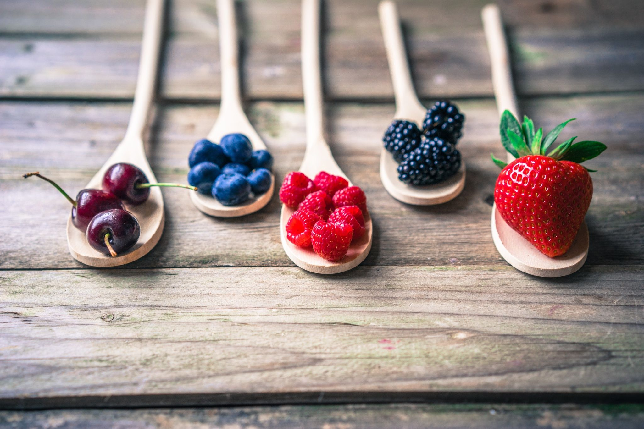 Berries on wooden rustic background by Alena Haurylik on 500px