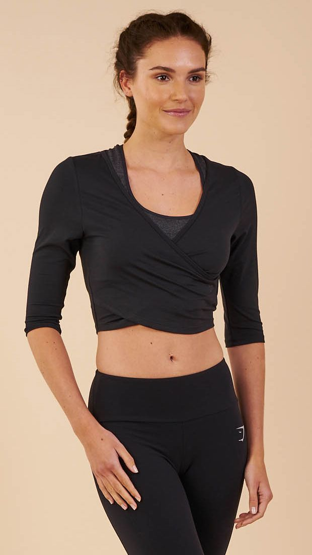 90bd614d6d436 With a crossover wrap neckline and 3 4 length sleeves