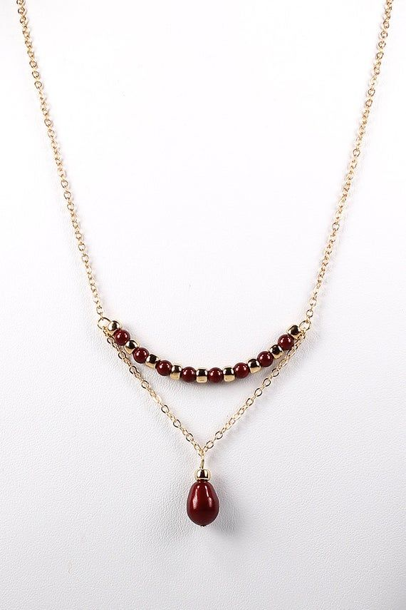 As seen on The Vampire Diaries and Legacies Necklace Oxblood and Gold Swarovski Pearl and Chain Trapeze Necklace Pearl Necklace
