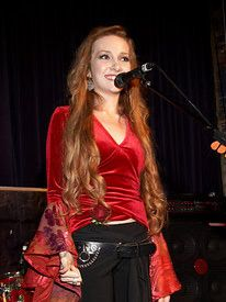 carlett performs on stage to benefit the National Eating Disorders Association.
