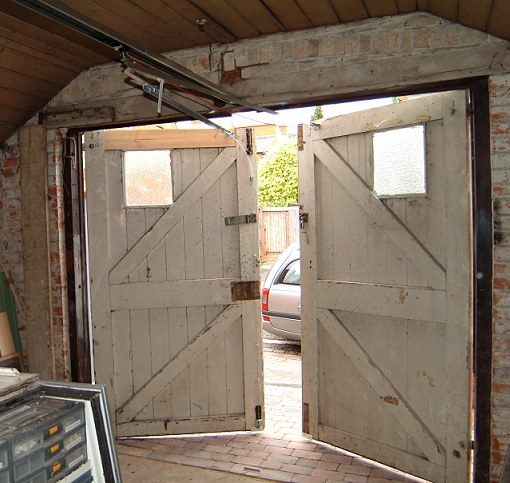 Pin By Leigh Smith On Old Barn Doors Wooden Garage Doors Barn Door Old Barn Doors