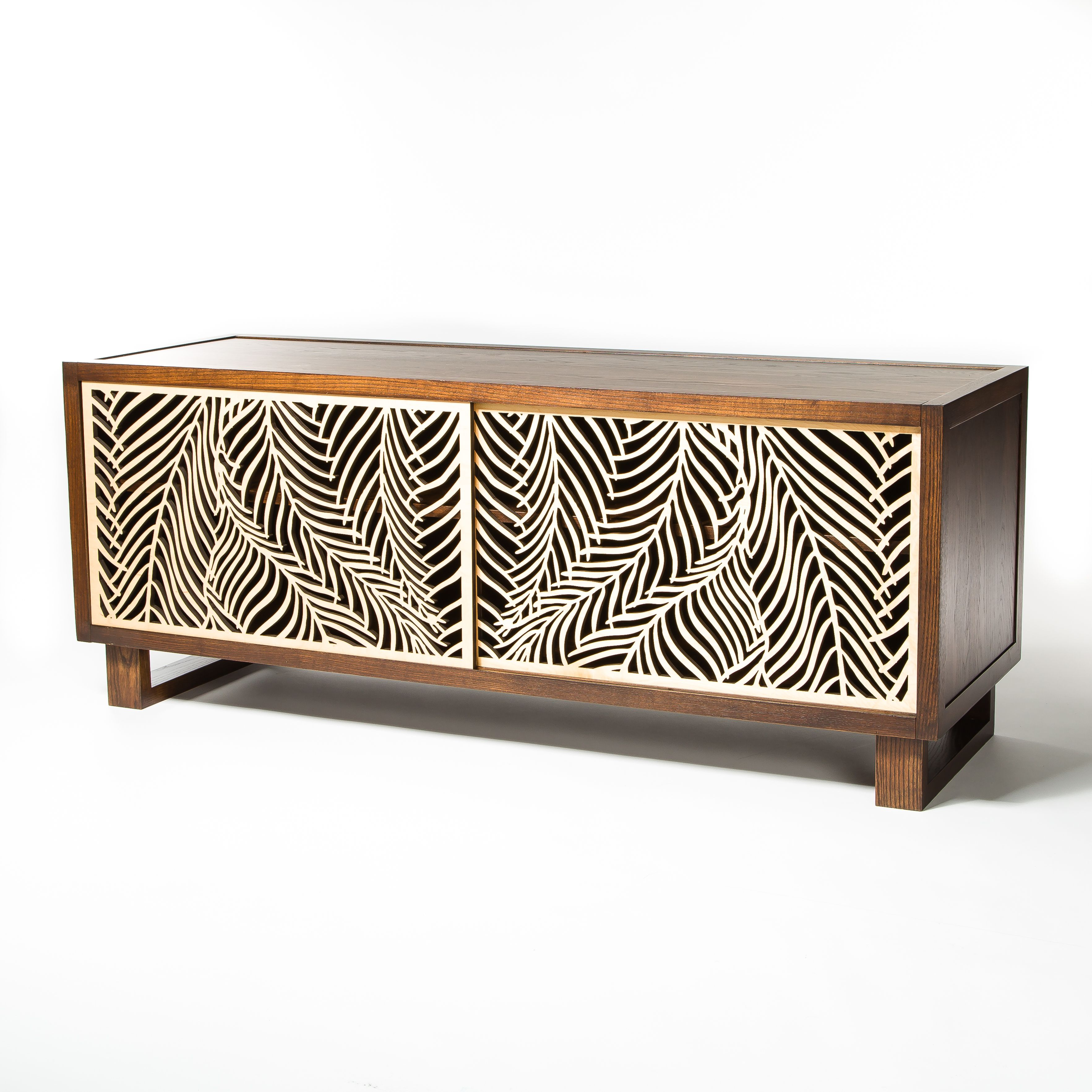 Beautiful credenza featuring intricate wispy palm laser cut door