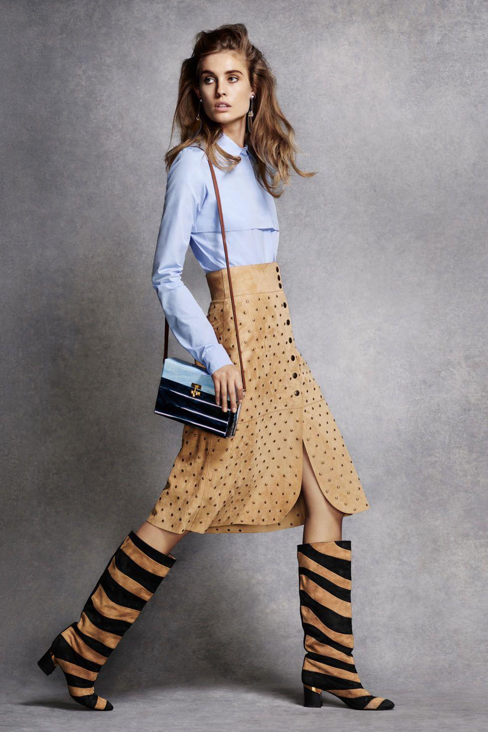 76350c1ee51e Nina Ricci top, $590, Ikram Chicago, 312-587-1000; Lanvin skirt, $5,150, Saks  Fifth Avenue, 212-753-4000, and boots, $1,650, 646-439-0308; Prada  earrings, .