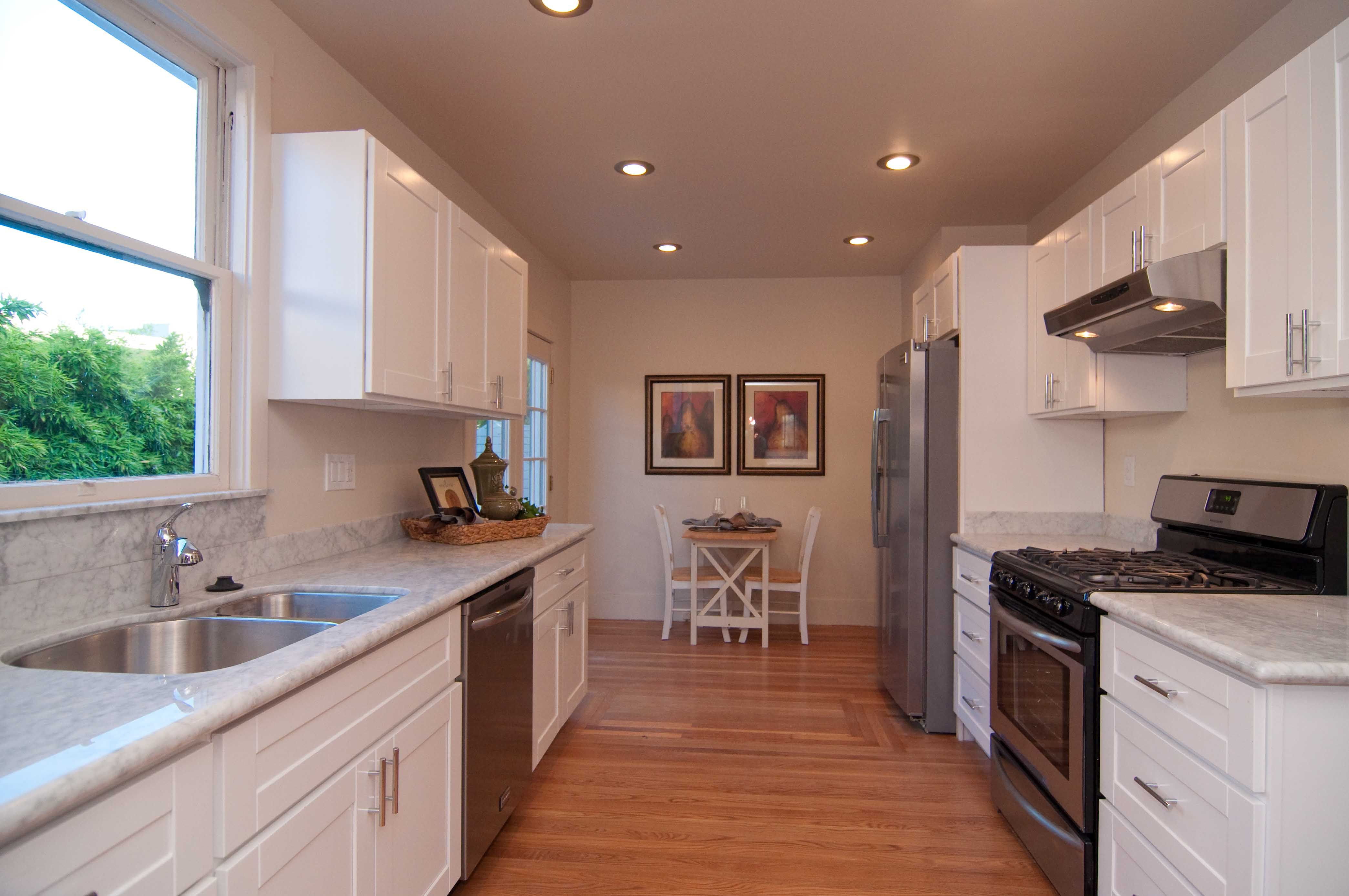 Kitchen Remodel From Oakland Ca Whitecabinets White Cabinets Hardwoodfloor Marblecountertop Residential Remodel Kitchen Marble Countertops