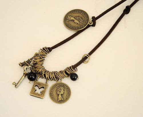 Adorable charm necklace on a leather thong