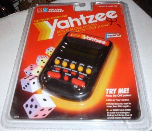 Electronic Handheld Yahtzee - Clear black by Milton Bradley. $109.00. Product Description LCD electronic handheld game.