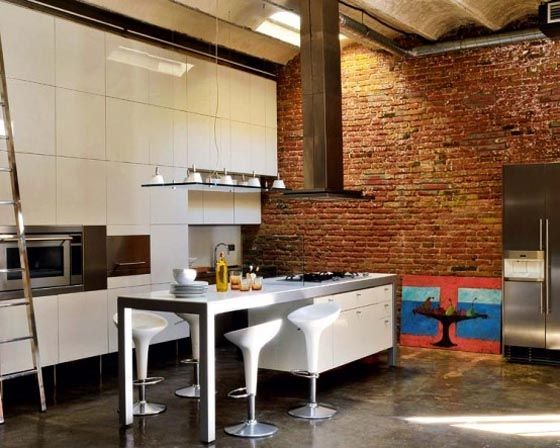 Renovated loft with modern industrial kitchen interior design