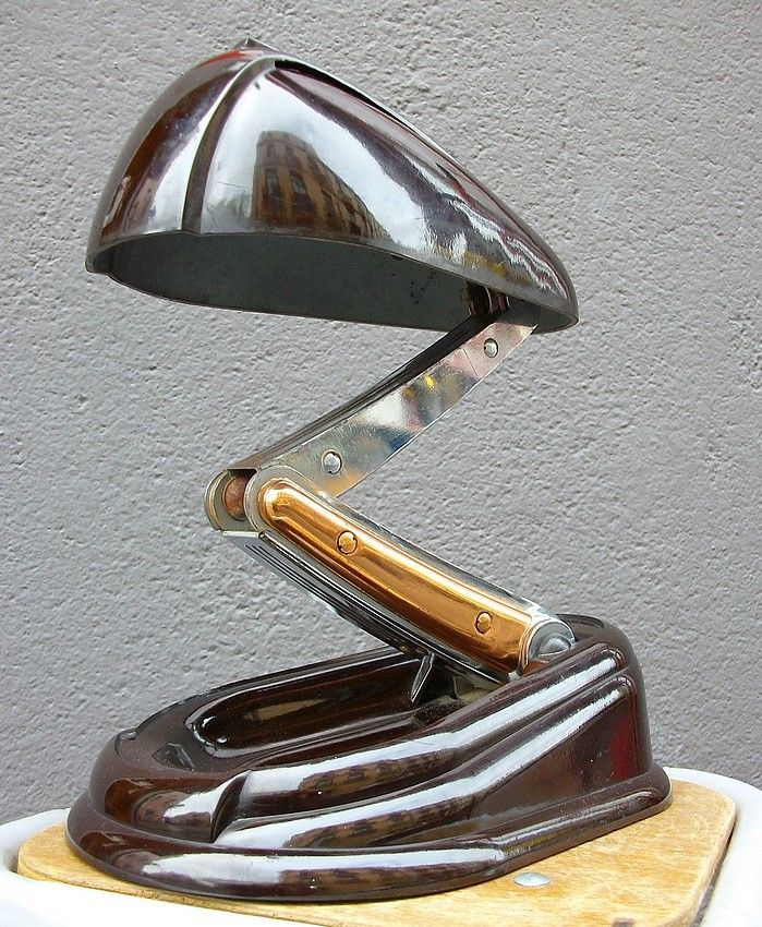 This 1940's Art Deco/Streamlined Design was designed in the border between the Art Deco era and the American Streamlined era, where it has an aerodynamic-shaped base, then a crane-like structure as the spine of the lamp. The lamp-head resembles an elongated bell, all made from chrome. I like this design because it shows an older-fashioned link between the Art Deco and the American Streamlined designs, to create a lamp of a traditional, yet new taste.