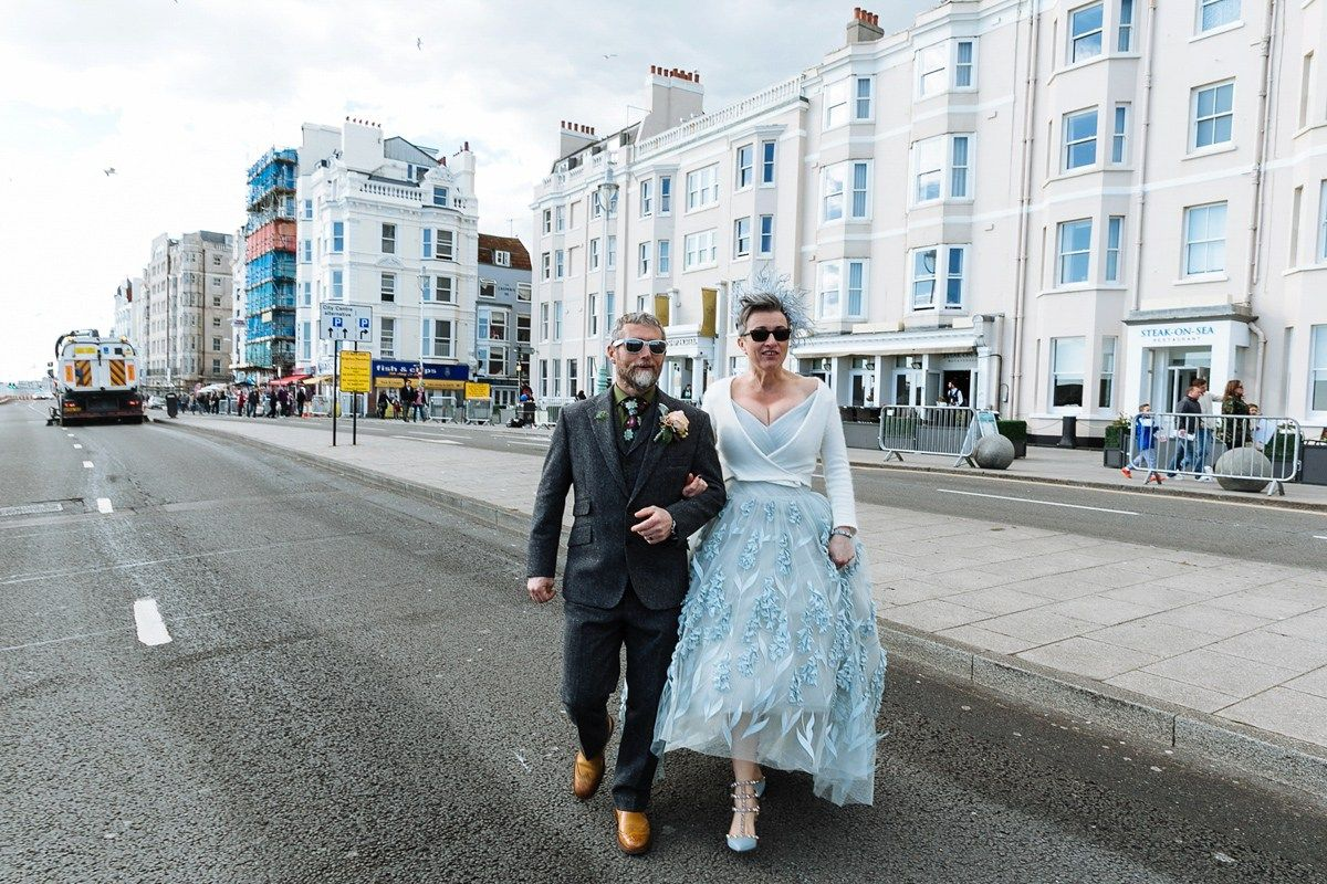 Emma and Marshy had a secret wedding in Brighton. Emma wore a bespoke blue dress by Suzanne Neville. Photography by Nick Tucker.