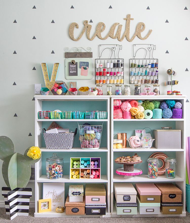 Tour this colorful and happy craft room that's bursting with creative storage ideas. #craftroom #crafts