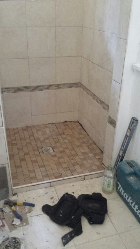 Shower Stall With 1x1 Mosaic Ceramic Tile Floor Over Poured In Place Wet  Bed With 12x12
