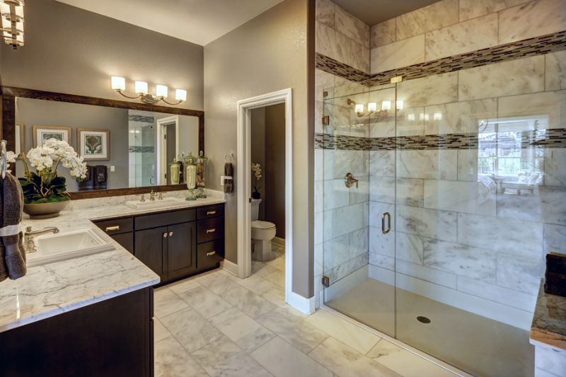 This Tiled Master Bath Has Dual Vanities A Gorgeous Shower And