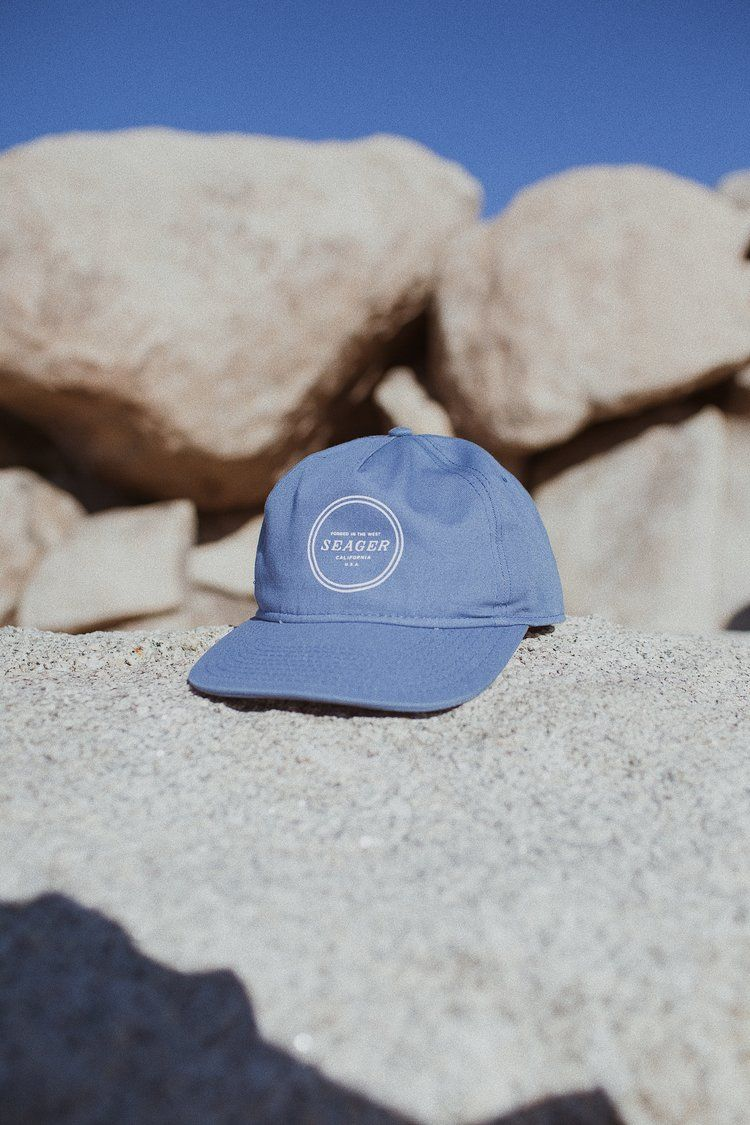 The 'Revolver' Snapback. A five-panel cut & sew snapback with a timeless design. Featured in Rust & Denim.   Forged in the West.