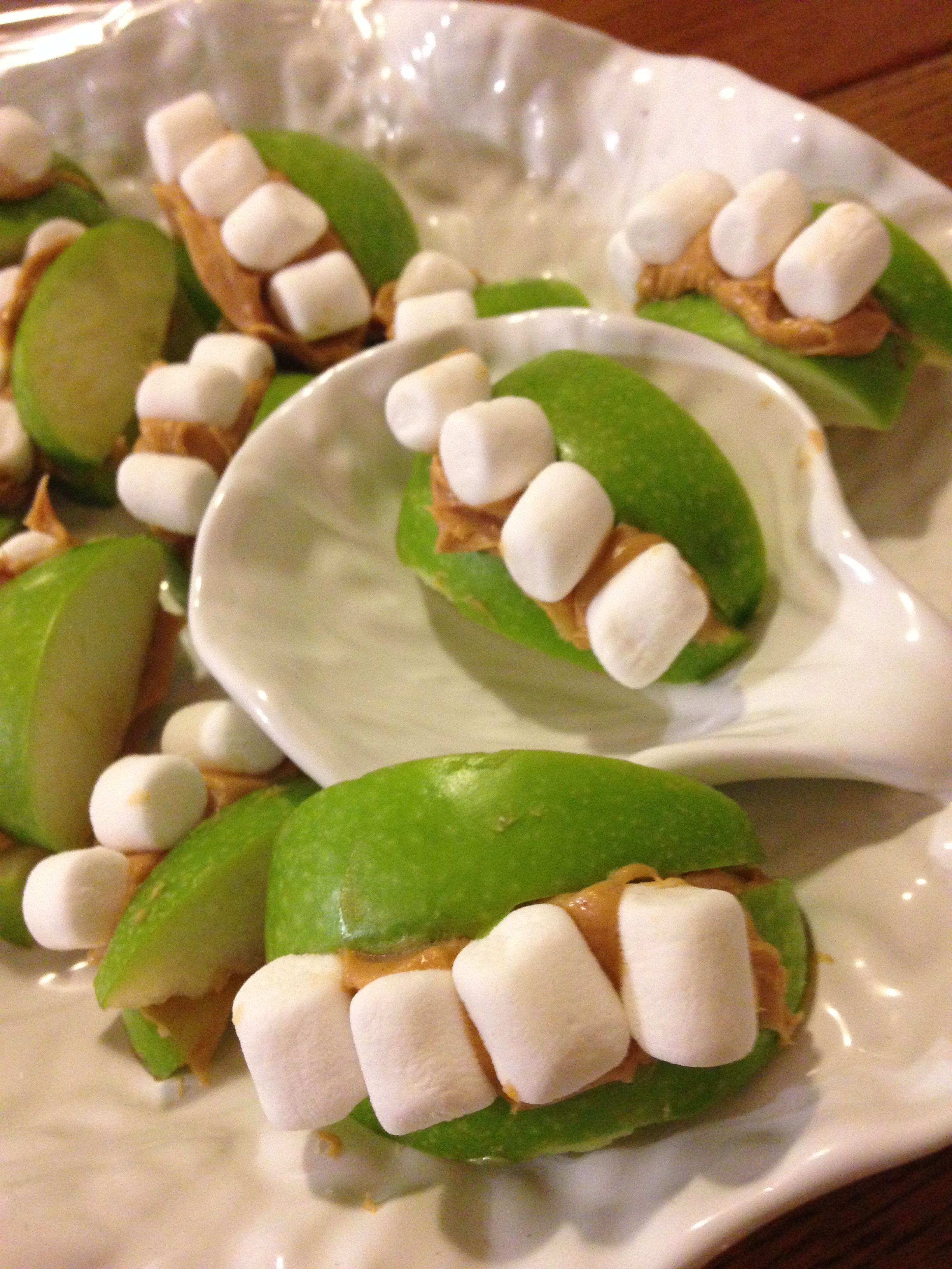 I made these monster teeth snakes at Halloween and they were a hit! Granny smith apple slices, peanut butter and mini marshmallows