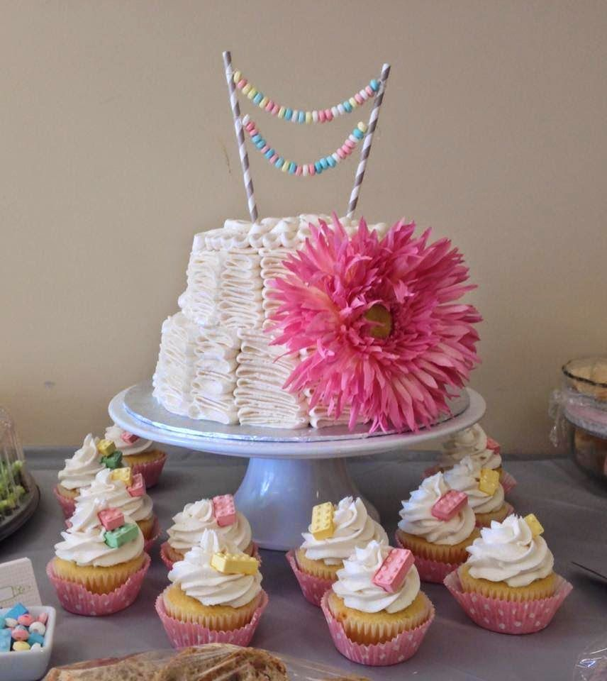 It's a girl Baby Shower cake and cupcakes. 2 tier cake