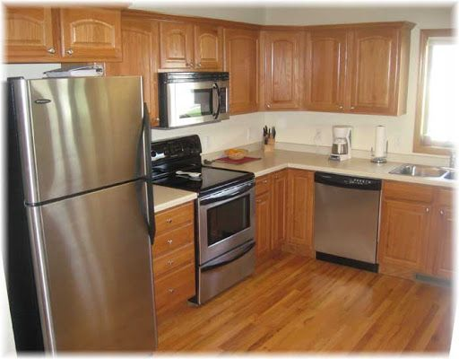 oak kitchen with stainless steel appliances - Google ...