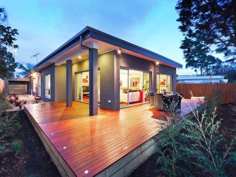 Indoor-outdoor outdoor living design with deck & ground lighting ...