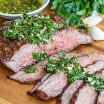 Chimichurri Steak is delicious combination of grilled flank steak and simple chimichurri sauce. It is a great summer grilling recipe for family dinners and 4th of July parties! We'll show you how to cook flank steak or skirt steak, how to cut it so the steak is tender, and then top it with chimichurri sauce for the perfect steak! #grilled #steak #summer #4thofjuly #homemadeinterest #recipesforflanksteak