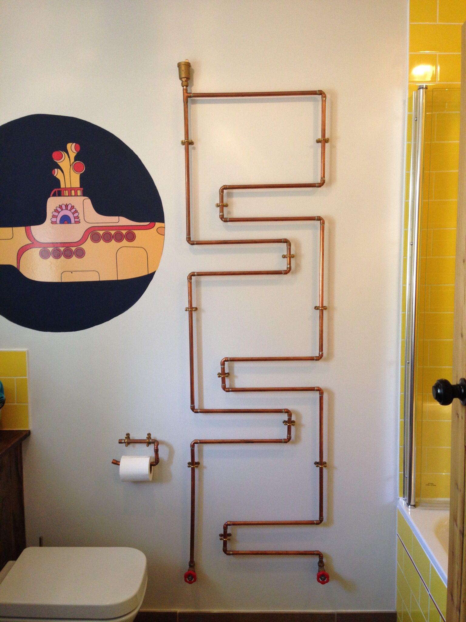 yellow submarine themed bathroom. copper pipe radiator