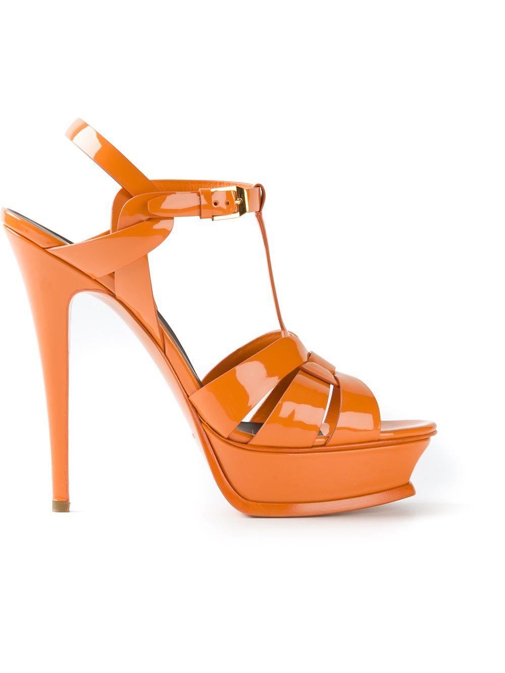 6f453ca23b4d Mandarine orange patent calf leather  Classic Tribute 105  sandal from  Saint Laurent featuring an open toe