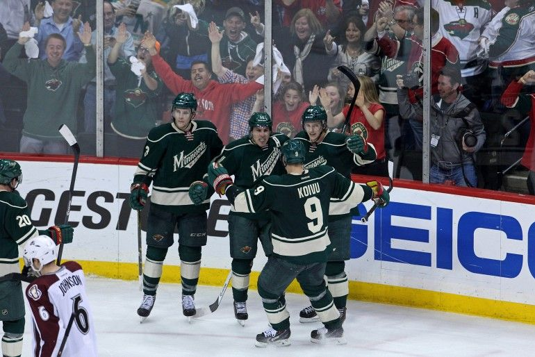 Apr 28, 2014; Saint Paul, MN, USA; Minnesota Wild forward Zach Parise (11) celebrates his goal with teammates during the third period against the Colorado Avalanche in game six of the first round of the 2014 Stanley Cup Playoffs at Xcel Energy Center. The Wild defeated the Avalanche 5-2. Mandatory Credit: Brace Hemmelgarn-USA TODAY Sports