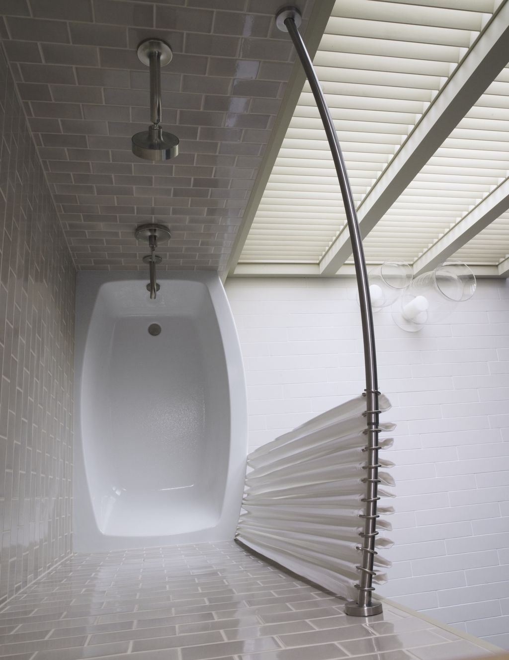 Expanse curved bath - makes sense to go with the curved shower rod ...