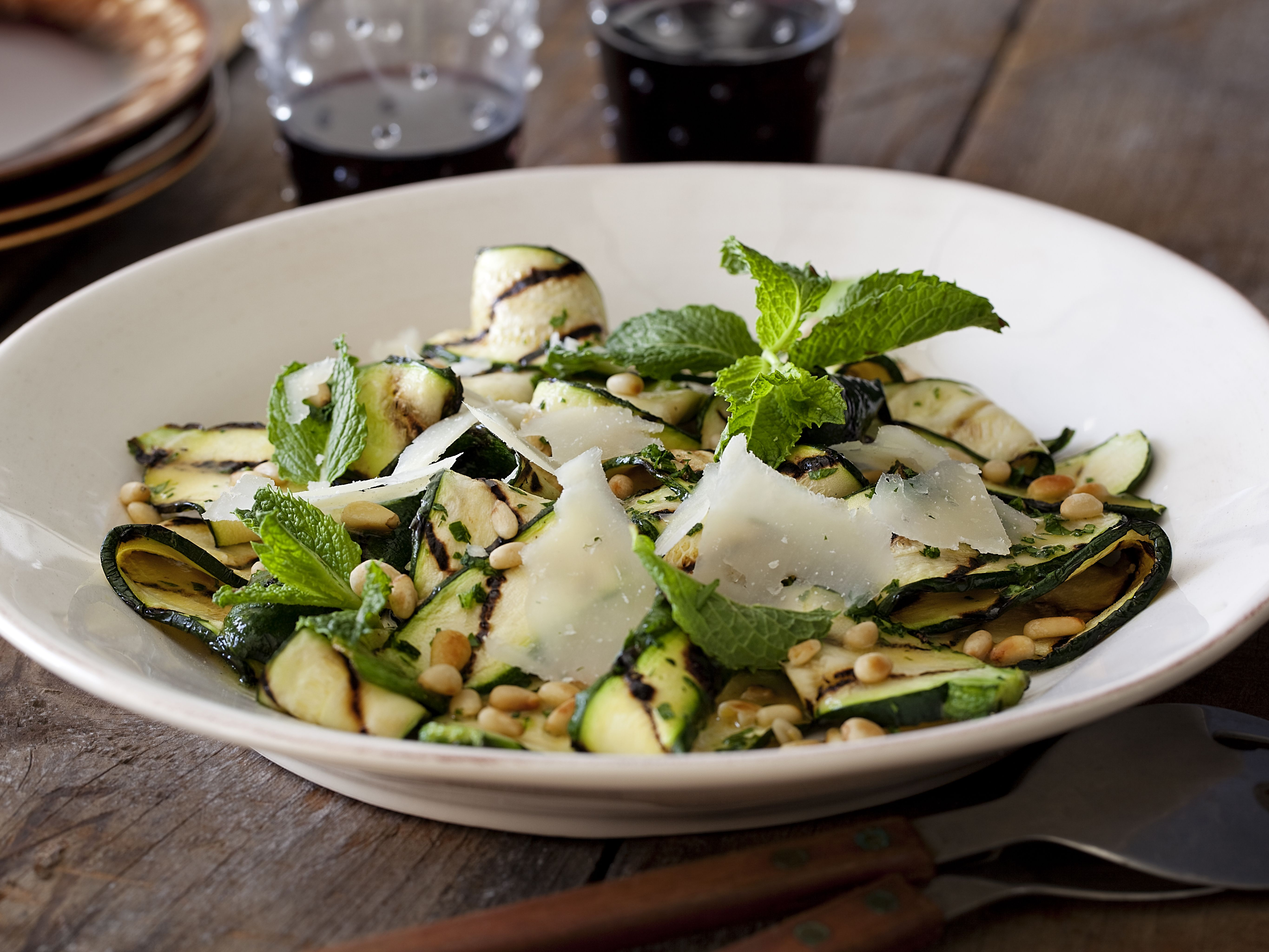 Grilled Zucchini Salad with Lemon-Herb Vinaigrette and Shaved Romano and Toasted Pine Nuts from FoodNetwork.com