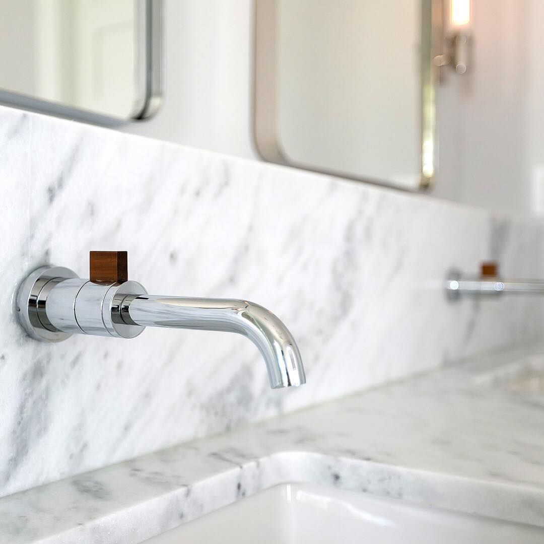The Litze Wall Mount Faucet In Polished Chrome With Teak Makes A
