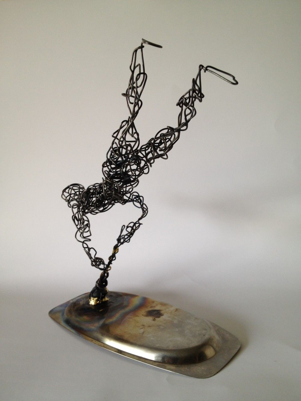 p>Back view wire sculpture Blown away</p><div class=\
