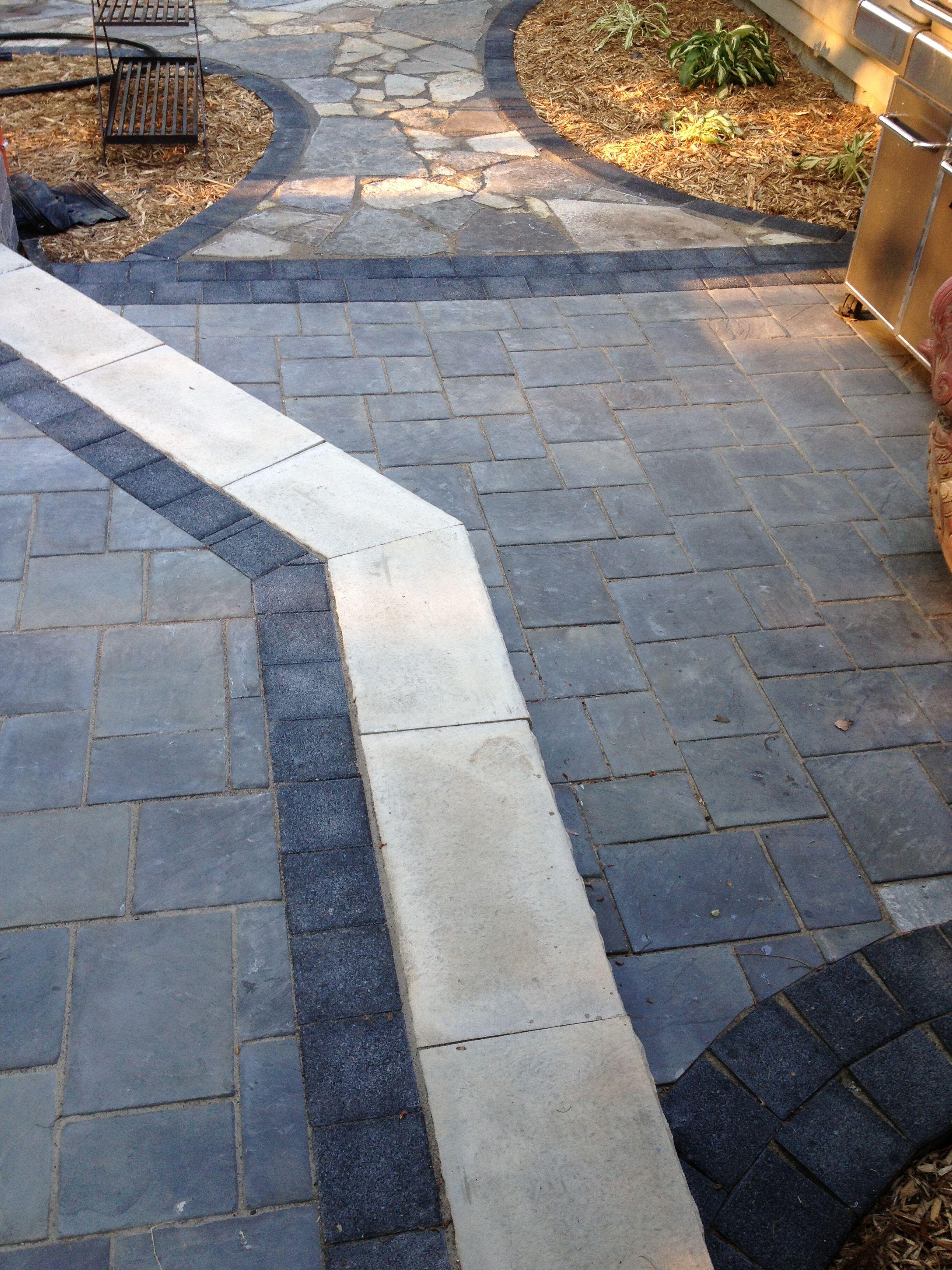 Beautiful Patio Using Unilock Brick Pavers Stonehenge Coping Series 3000 Black Accent Brick And Richcliff Patio Patterns Ideas Paver Patio Brick Paver Patio