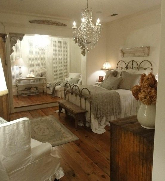 Beautiful Master Bedroom Vintage Decor With Wood Floor, Iron Bed, Eyelet  And Chandelier.