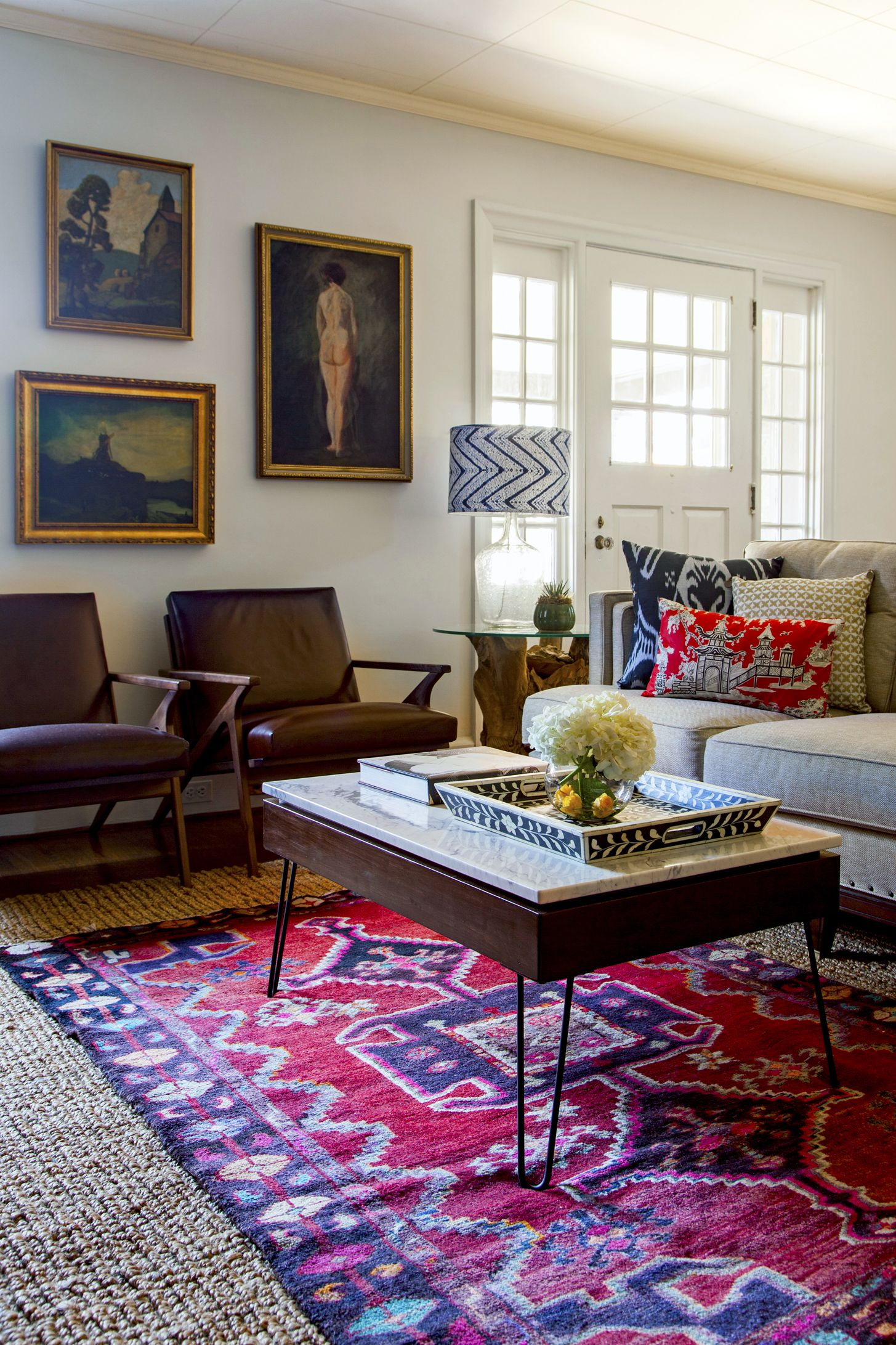 Tribal rug layered over jute design manifest inspiring - Pictures of area rugs in living rooms ...