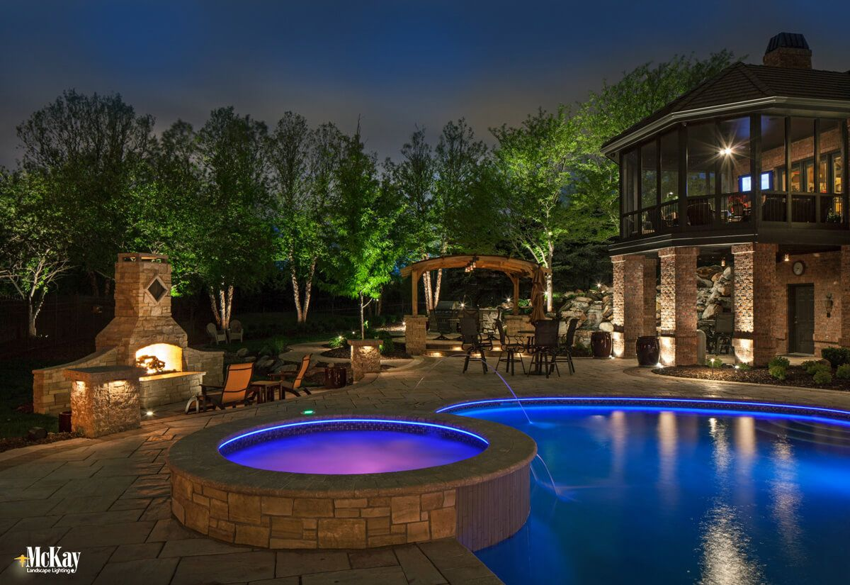 Explore The Landscape Lighting Design Of This Outdoor Oasis In Omaha Nebraska From Lighting Exterior Lighting Design Outdoor Lighting Design Pool Landscaping