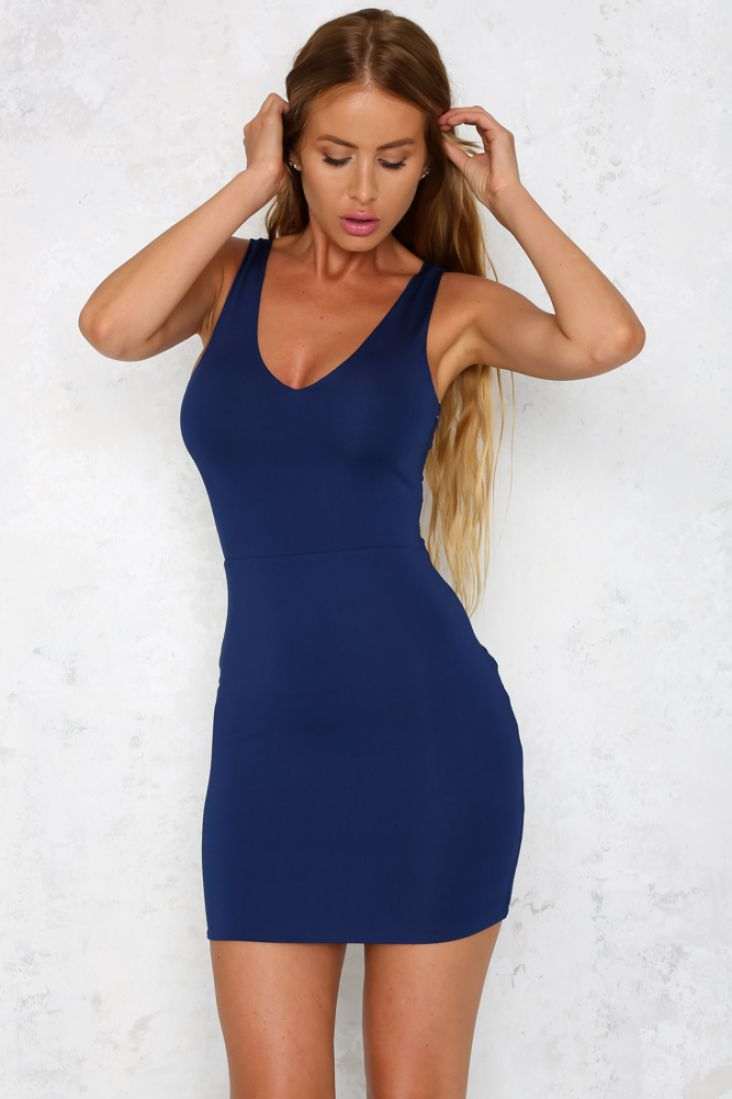 The figure hugging Dirty Talk Dress is a style that will never go out of fashion! The mini dress features stretchy fabric, a V-neckline at the back and front and a slit cutout on the back. There is also an invisible zip down the side of the dress. Pair it with some strappy heels and hit the town!   Mini dress.  Lined.  Cold hand wash only. Model is standard XS and is wearing XS. True to size. Polyester.