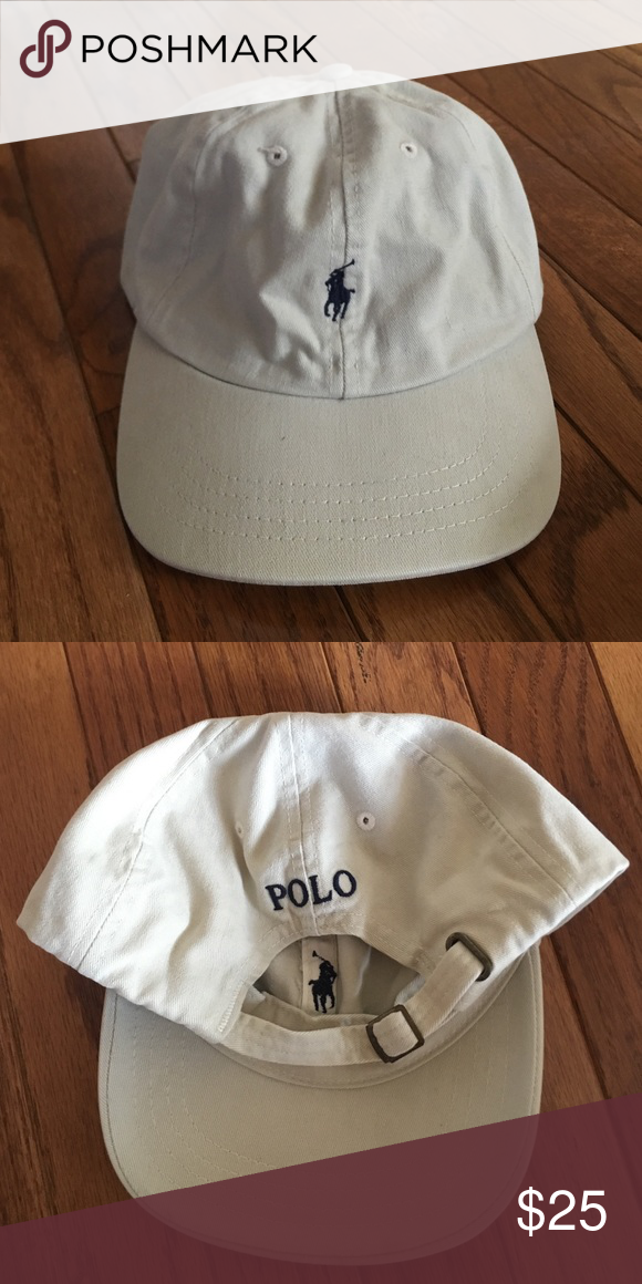 Brand new khaki colored Polo Ralph Lauren hat Brand new beautiful, khaki Polo Ralph Lauren hat! Front has the polo horse symbol stitched in navy blue. The back has an adjustable strap with POLO also stitched in navy blue. Polo by Ralph Lauren Accessories Hats