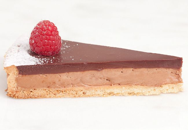In March and April, Lady M Confections entices with the cake of the month – the Raspberry Chocolate Tart.