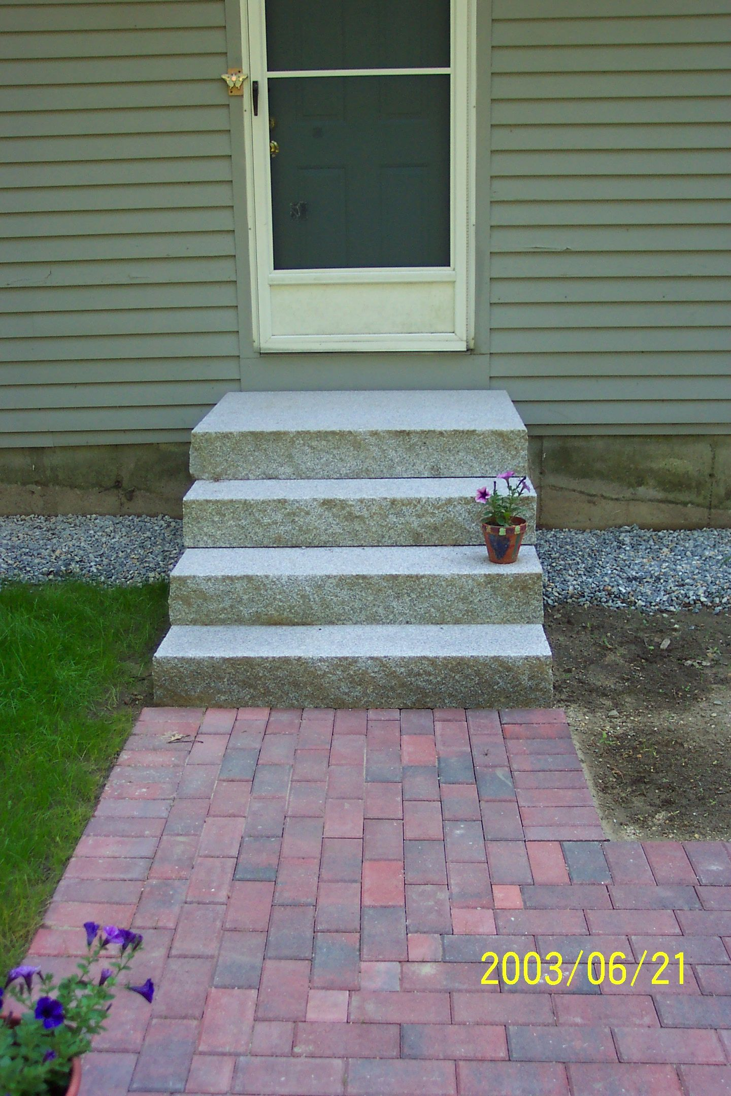 A Brick Walkway Leading To Granite Steps Outdoor Steps Front Steps Patio Design