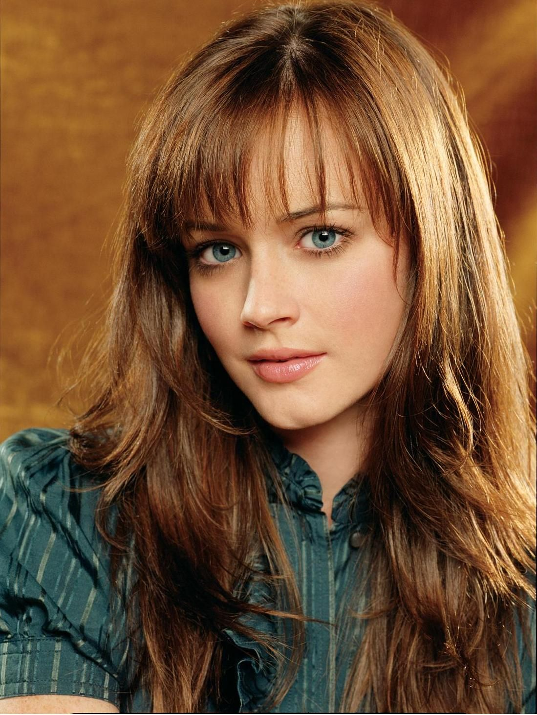 The Pale Brown Haired Girl With Blue Eyes Too Big For Her Face