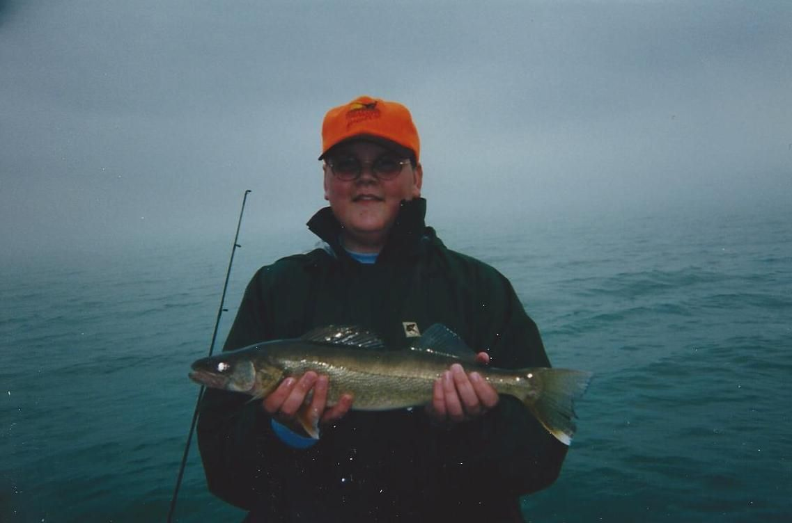Brandon with his first Lake Erie walleye - spring break 2001