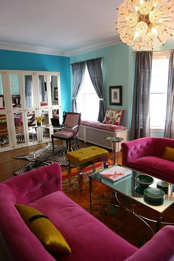 bright colours Living room Teal wall blue wall pink couch