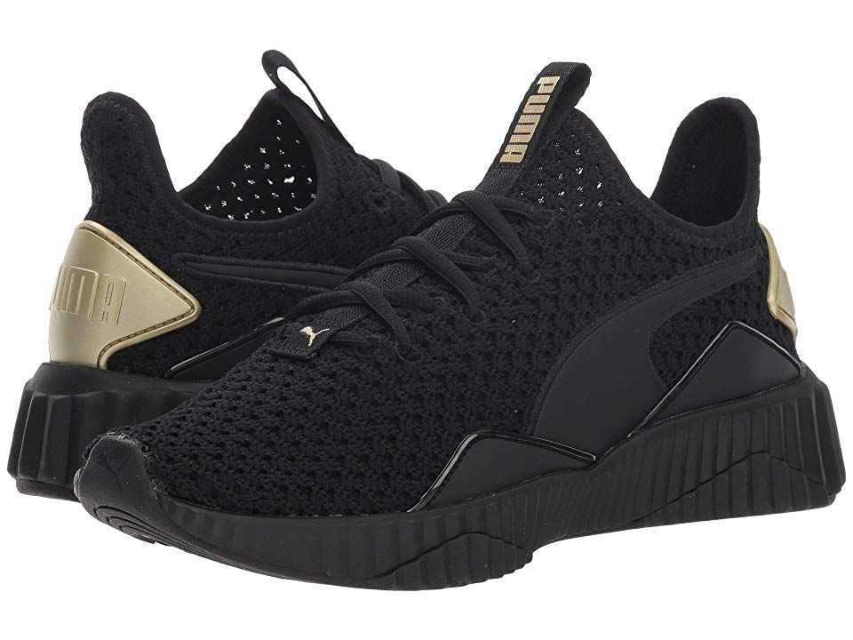 78dd1216a467e7 PUMA Defy Varsity (Puma Black Metallic Gold) Women s Shoes. Find your stride