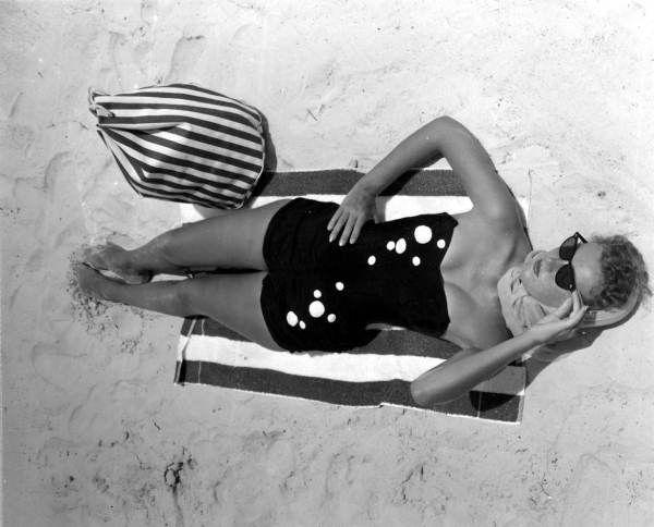 Nancy Owens sunbathing on Daytona Beach. 50s summer style. (State Archives of Florida)